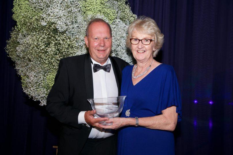 Shropshire's Cathie Sabin receives her award from David Rawlinson, Deputy President of the LTA
