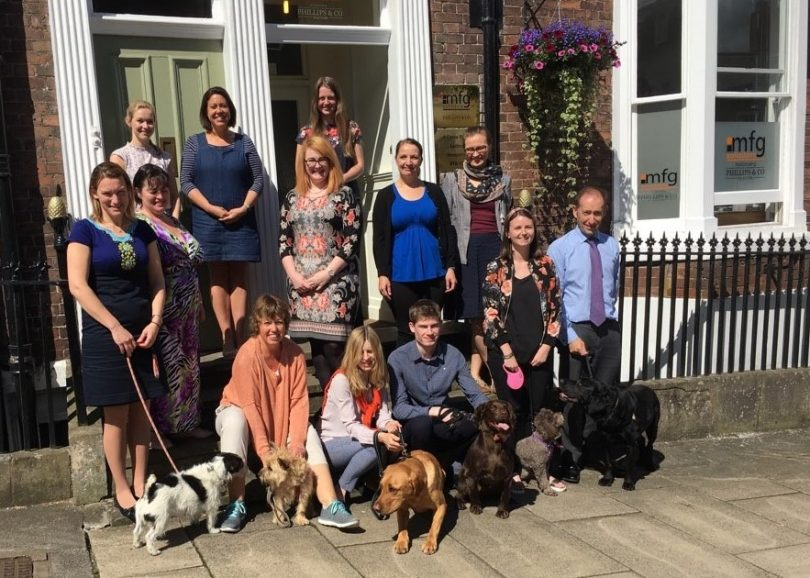 Staff at mfg Solicitors with their dogs