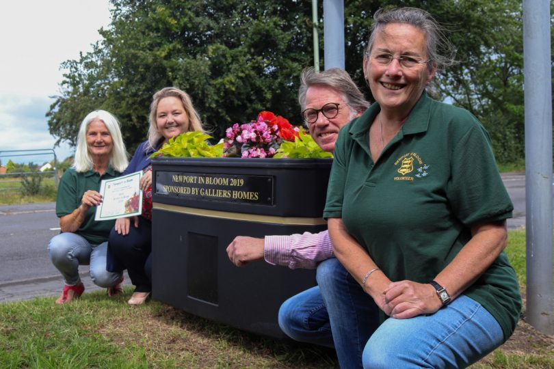 Pictured from left, Maggie Duggan of Newport in Bloom, Sharon Taylor of Galliers Homes, Karen Claxton of Newport in Bloom and Paul Skitt, who was responsible for the planting the two planters