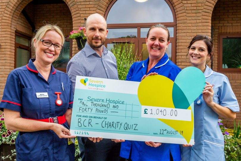 Severn Hospice Matron Clare Gregory, Staff Nurse Abbi White and Nursing Assistant Katy Broxton welcome Nick West of BCR Shrewsbury to the hospice in Bicton Heath where he handed over a cheque for £1,040