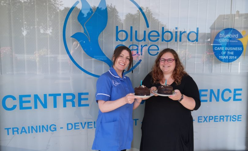 Bluebird Care Specialist Care Coordinator Kirsty Holland and live in carer Claire Matthews celebrate one year of live-in-care