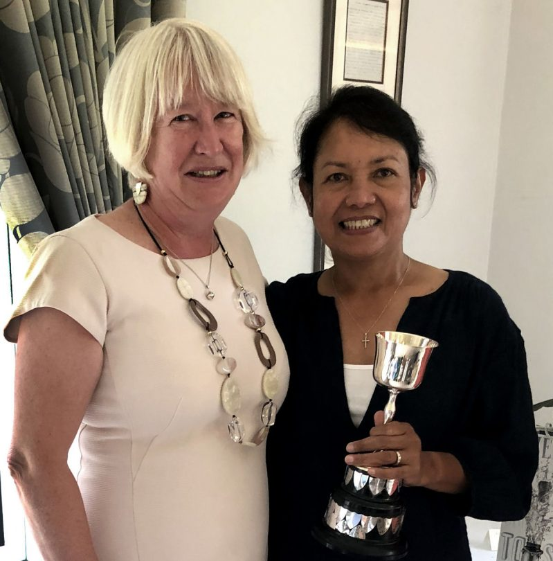 Ladies Captain Joy Foster presenting Marlyn Radford with the Away Day Trophy. Photo: Vanessa Statham