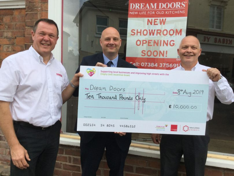 The Wellington showroom will be headed up by local businessman Chris Nowell pictured with Cllr Lee Carter and colleague