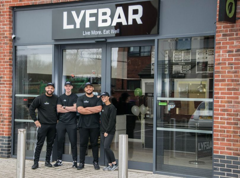 Alex Archibald and Bethany Tomlinson pictured in the right of the photo with their team at Lyfbar in Lawley, Telford