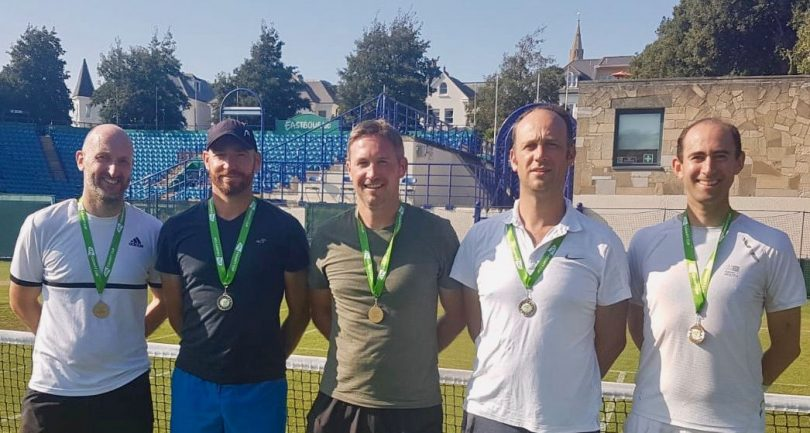 Pictured celebrating promotion at Eastbourne's Devonshire Park are Shropshire's over-35s men's team, from left, James Knight, Adam Baldwin, Ian Gillespie (captain), Hugh Jaques and Chris Dowden