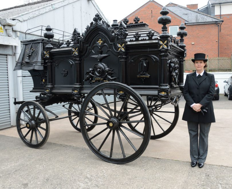 Cathy Ellis with the restored hearse which will be on display at Shrewsbury Flower Show