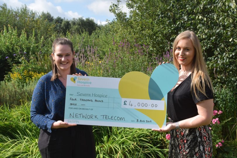 Amelia Ebdon and Becky Homersley from Network Telecom present the £4000 cheque