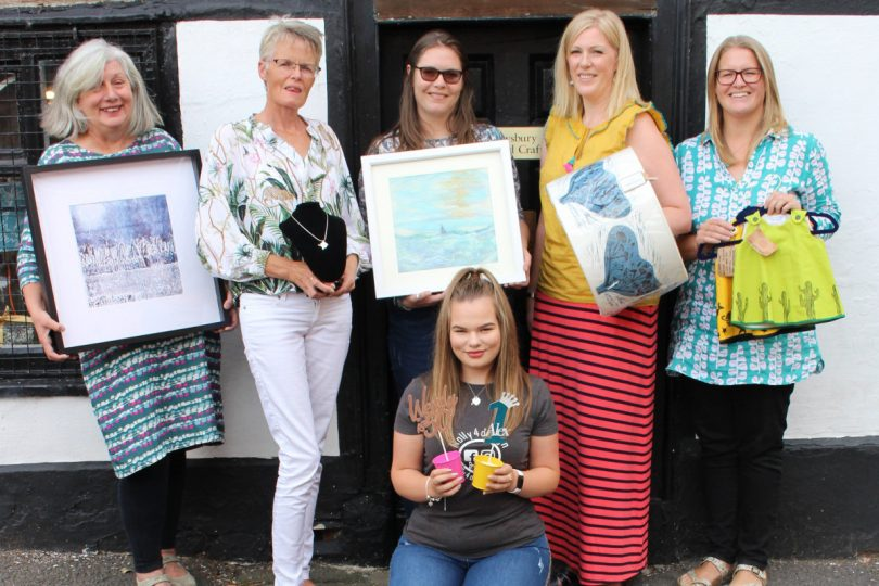 Jessica Richards with some of the artists outside Perches House in Windsor Place