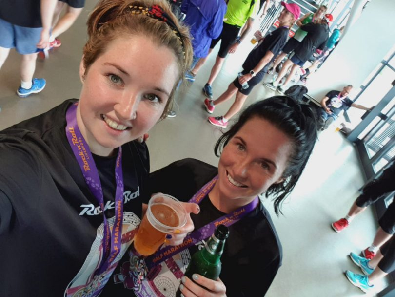Erin Fletcher and her sister Siobhan Williams celebrate after finishing Liverpool Half Marathon in May