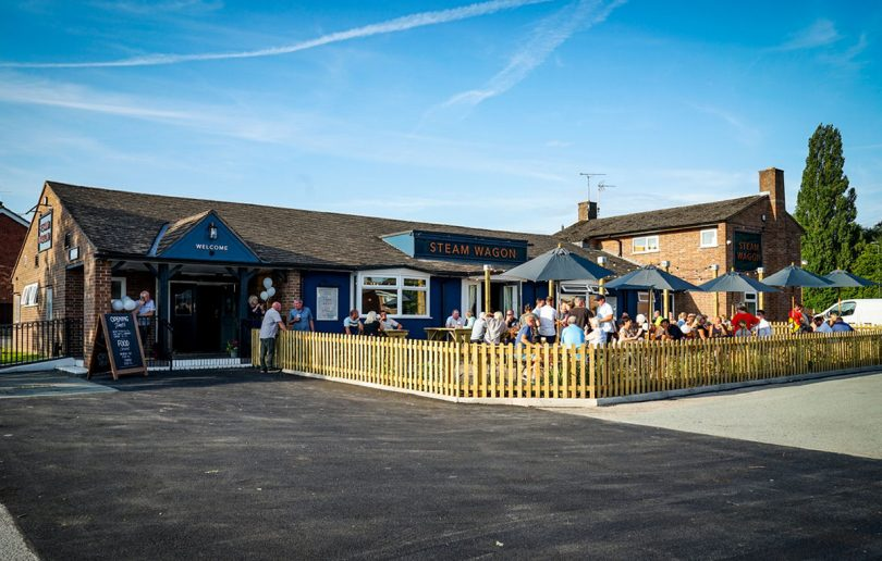 Customers enjoying the sunshine on the day the pub reopened