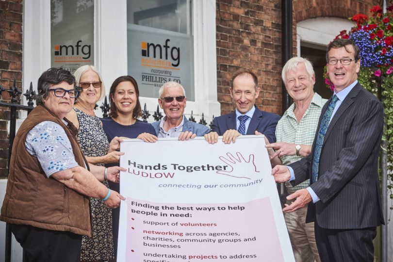 Staff at Ludlow firm held events throughout the past year for the charity Hands Together, a group which co-ordinates volunteers and other charities to support community cohesion and aid local people