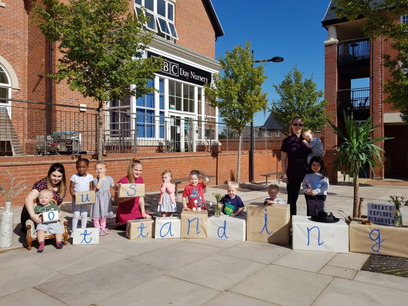 Children and staff at ABC Lightmoor celebrate their Ofsted Outstanding rating in the sunshine