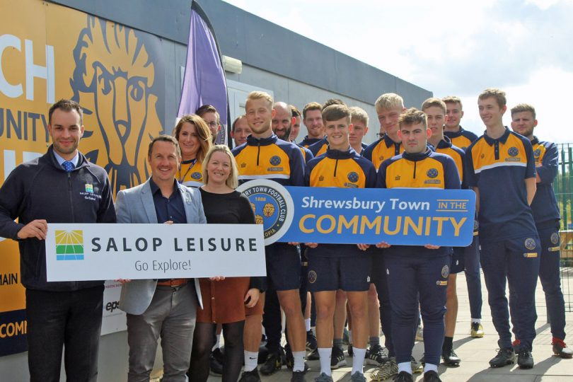 Salop Leisure's marketing manager Ed Glover (left) with Shrewsbury Town in the Community's head of community Jamie Edwards, partnerships and events manager Ceri Nicholls and staff