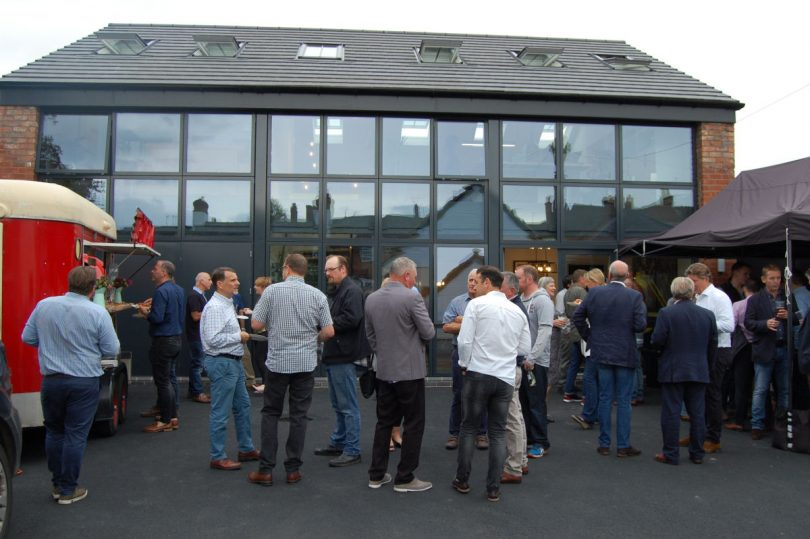 Staff, friends and partners enjoy the opening celebrations of The Warehouse on Longden Road, Coleham