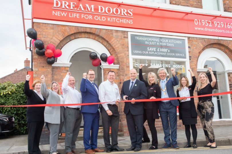Councillor Lee Carter cuts the ribbon at Dream Doors Telford. He is stood next to showroom owner Chris Nowell. Photo: Telford & Wrekin Council