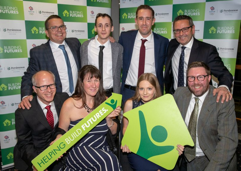 Stephen Cleveley, director-in-charge of Persimmon Homes West Midlands, back right, with head of sales David Greengrass, back second right, with finalist representatives for Challenging Perceptions, Newport Girls' Football Club and Lichfield Garrick Theatre