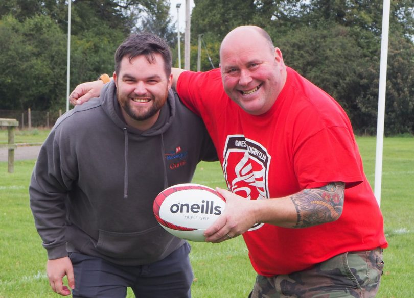 Curtis Langley, Fundraising and Marketing Officer at The Movement Centre With Warren Howell from Oswestry Rugby Club