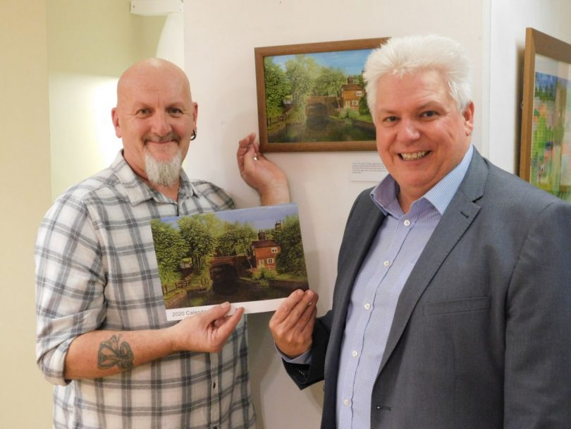Previous overall calendar competition winner Dave Hughes (left) with Wayne Gethings, chief exec of Wrekin Housing Group