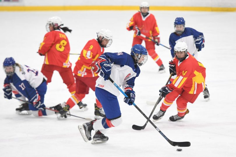 Grace Garbett battles for the puck against China during GB u18s bronze medal winning World Championships campaign