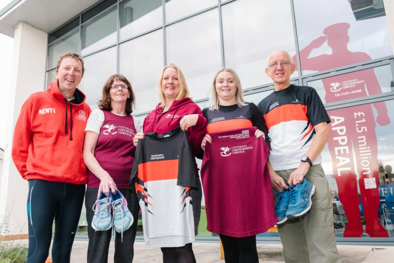 Members of The Marches School Oswestry 10k organising committee - Dave Newton, Ellen Harrison, Ashling Donohue-Harrison and Ray Pickett with Helen Knight, RJAH Fundraising Manager (centre)