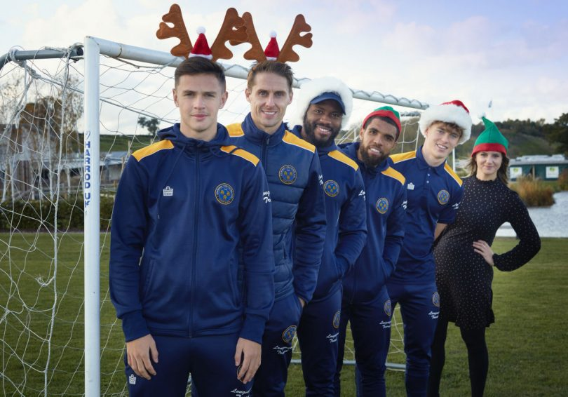 Promoting the Salop Santa Dash are Shrewsbury Town footballers (from left) Ryan Barnett, Dave Edwards, Lenell John-Lewis, Scott Golbourne, Luke McCormick and Laura Wilde, Salop Leisure marketing assistant