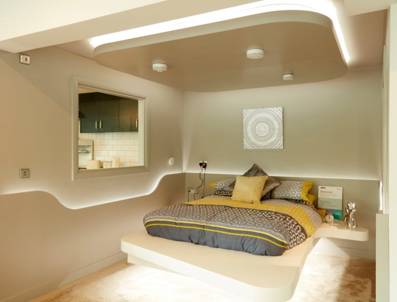 Aico's futuristic bedroom with bed with two side tables and LED lighting made and fitted by Morris Joinery