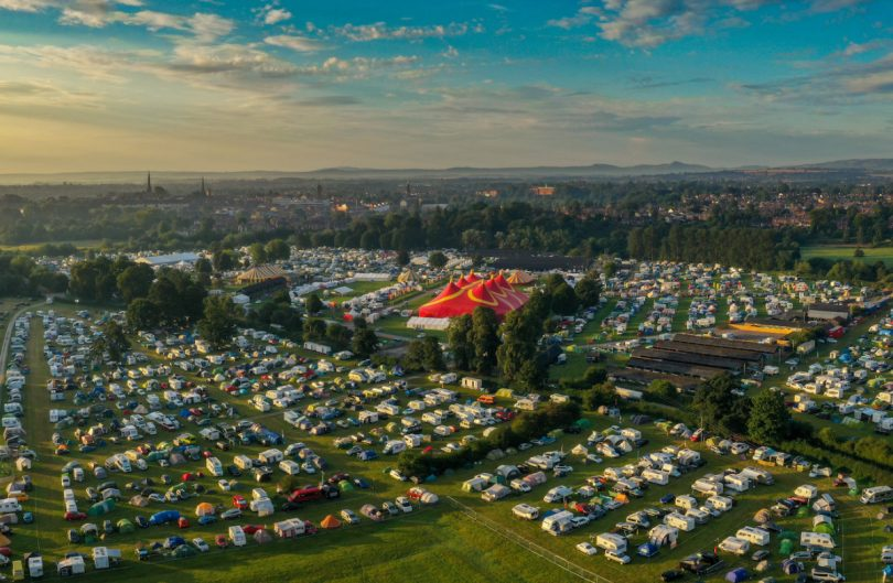 The festival has four main music stages, a dance tent, children and youth festivals, workshops, a craft fair, food village, real ale, cocktail and gin bars and on-site camping and glamping. Photo: Drone Rangers