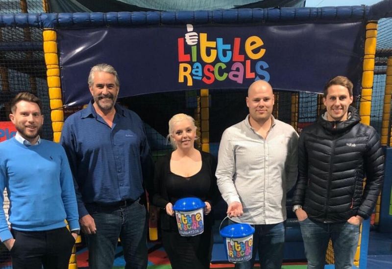 Staff from 1st Choice Insurance join staff from Little Rascals after nominating them as their charity of the year - Ben Wootton, Ken Baker, Rose Stephen, Jason Martin and Dave Edwards