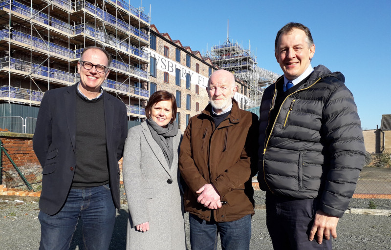 The Shrewsbury Flaxmill Maltings project partners outside the Main Mill on site Left to right: Historic England's Project lead for the Shrewsbury Flaxmill Maltings restoration, Alastair Godfrey; Shropshire Council's Assistant Director for Economic Growth, Gemma Davies; Chair of the Friends of the Flaxmill Maltings, Alan Mosley; Deputy Leader and Portfolio Holder for Assets, Economic Growth and Regeneration for Shropshire Council, Cllr Steve Charmley