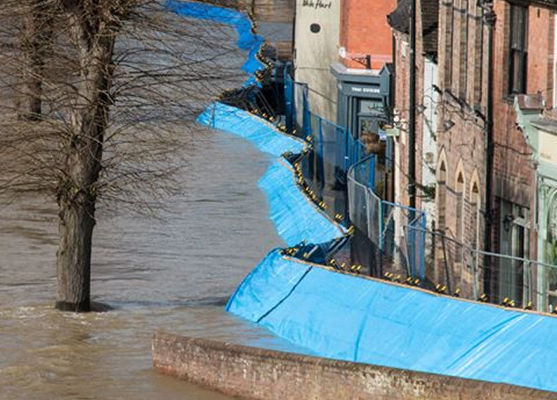 The flood barriers along the Wharfage moved after being overwhelmed by the volume of flood water. Photo: Barry Jones