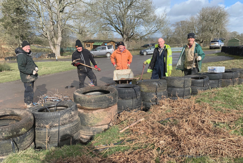 All smiles, Martyn Silcox (centre) with fellow volunteers working on the tyre wall at Triangle Bend, Loton Park Hill Climb