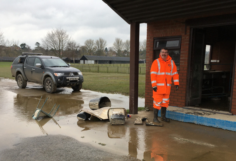 Ian Bebbington, chief executive of the Shropshire and West Midlands Agricultural Society cleaning up after the flooding