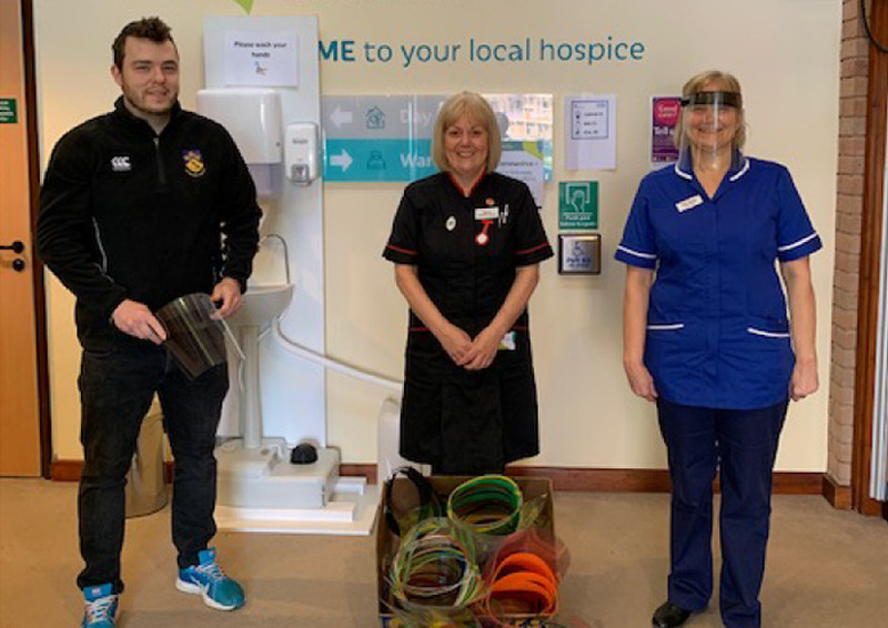 Matthew Horton, Head of Design and Technology at Ellesmere College in Shropshire hands over some of the visors to staff at Severn Hospice