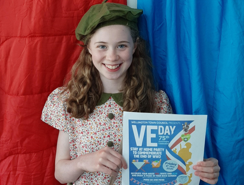 Scarlett Mulvihill gets dressed up and in the mood for the Wellington VE Day celebrations