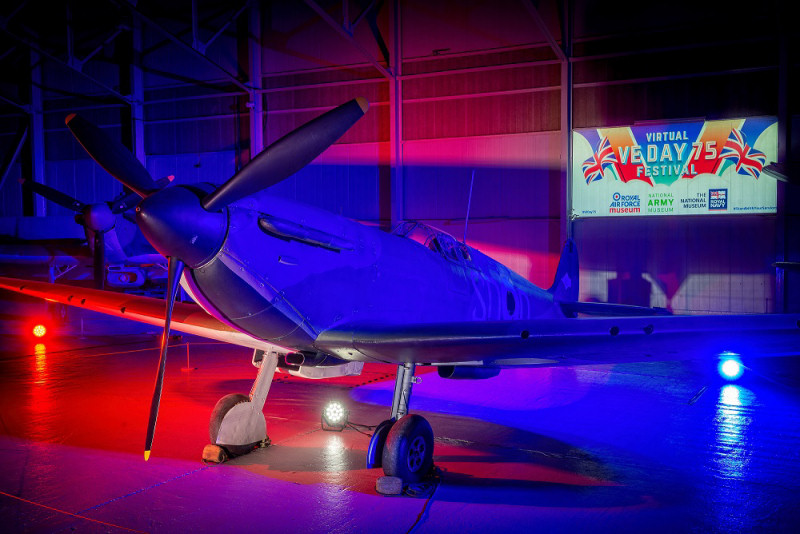 The world's oldest Supermarine Spitfire Mk1 on display at the Royal Air Force Museum Cosford is illuminated red, white and blue to mark the 75th anniversary of VE Day.