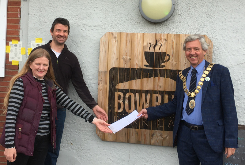 Donna Miles and David Cheshire pictured being handed their new lease by Wellington Mayor Anthony Lowe