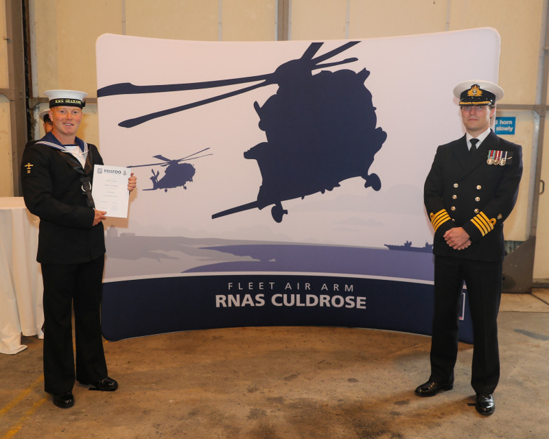 Pictured with Mathew Vickers is Royal Naval Air Station Culdrose commanding officer Captain Stuart Finn, who should be shaking their hand but in these socially-distant days is standing to one side instead. Photo: Royal Navy