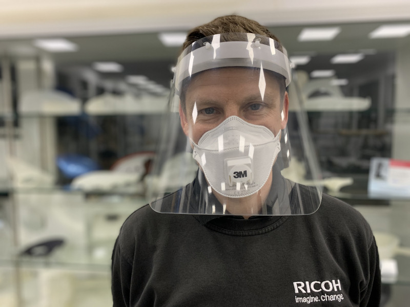Ricoh's Rich Minifie modelling one of the face shields