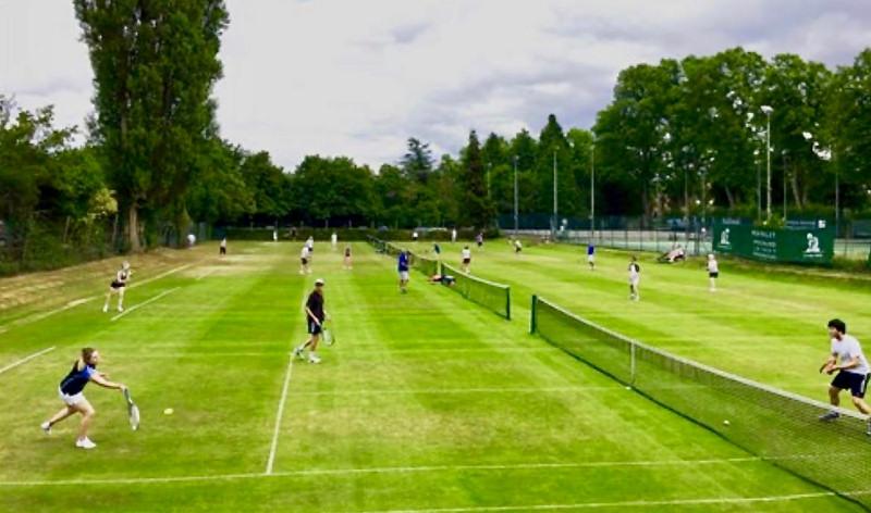 Players enjoying tennis at Shrewsbury Lawn Tennis Club