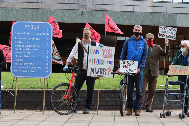Extinction Rebellion protesters erect a highway mileage sign outside Shirehall to protest against the North West Relief Road. Photo: Chris Davenport
