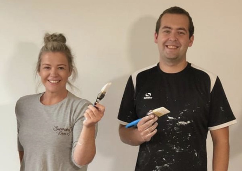 Jess and Otis Painting at their new offices in Shrewsbury