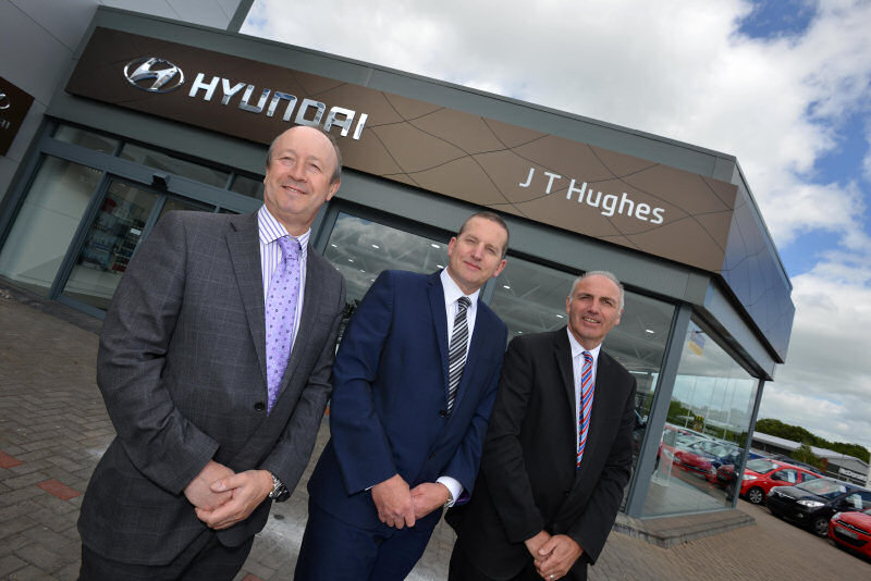 John Hughes (Managing Director of the JT Hughes Group) pictured with Paul Tench (Group Sales Director) and Ian Jones (Group Aftersales Director)