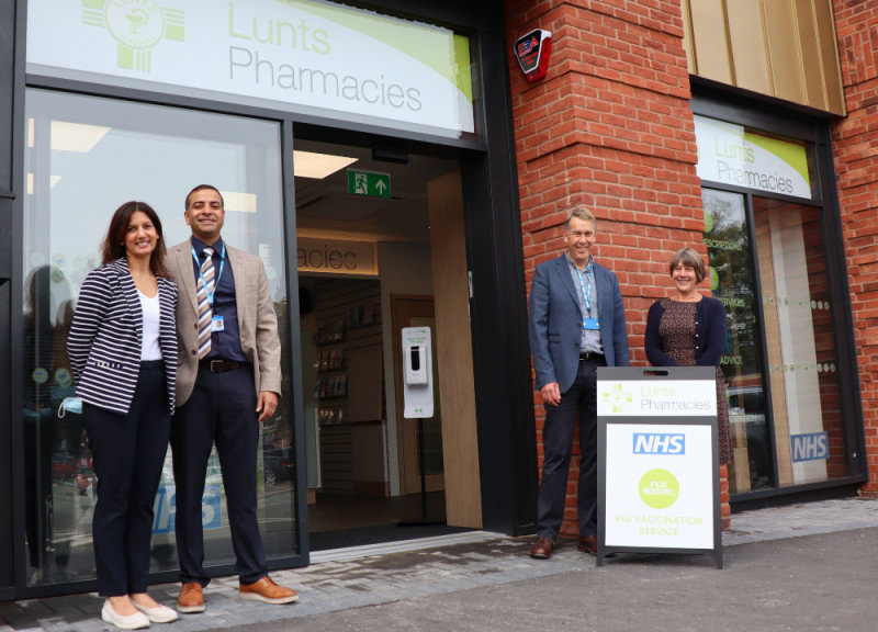 Pictured outside the new pharmacy are Ravi and Anj Nagra with Martin and Christine Lunt