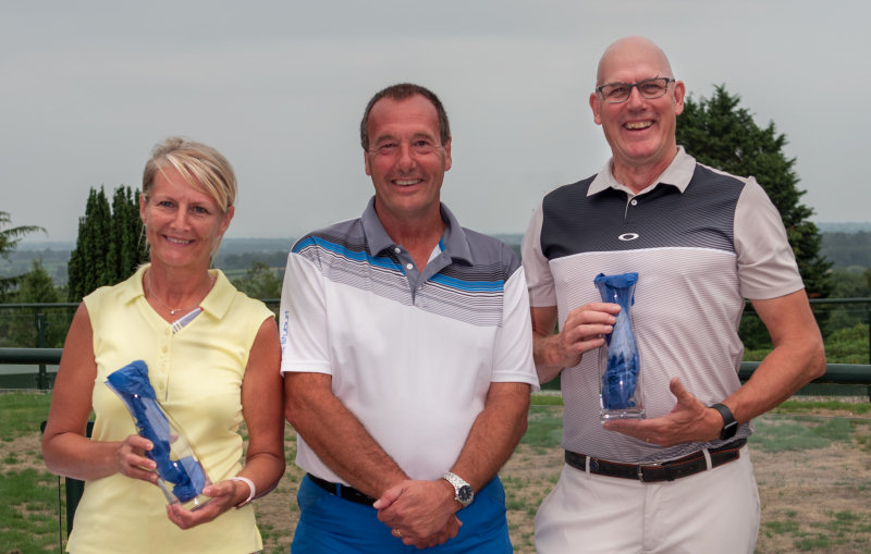 The winners of the trophy in this three day event were John and Mary Harper who are pictured with Lilleshall Hall Golf Club Captain Terry Beech