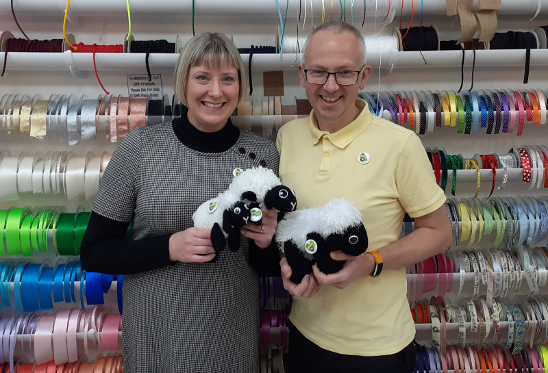 Pictured with some of the first sheep, husband and wife Adrienne and Dave Taylor. Adrienne runs the Dabberhashery in Wellington Market and Dave owns Saturday Cycles in the town.