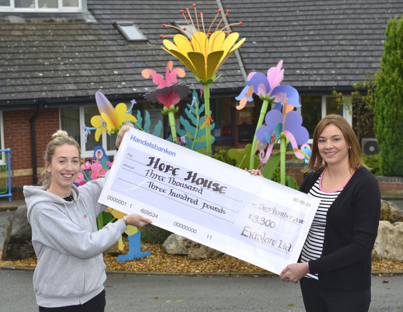 Bekki Fardoe (left) receives the cheque from Vicky Bradbeer