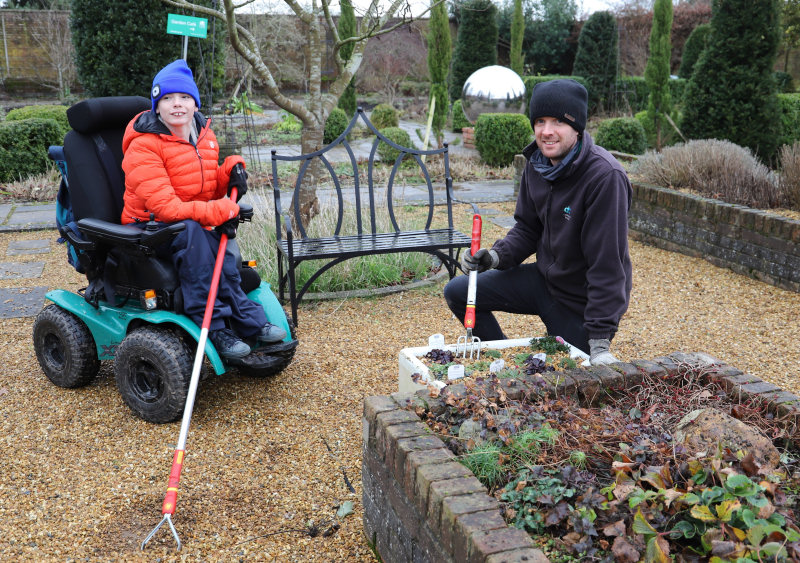 Oliver and Will clearing the Walled Garden.