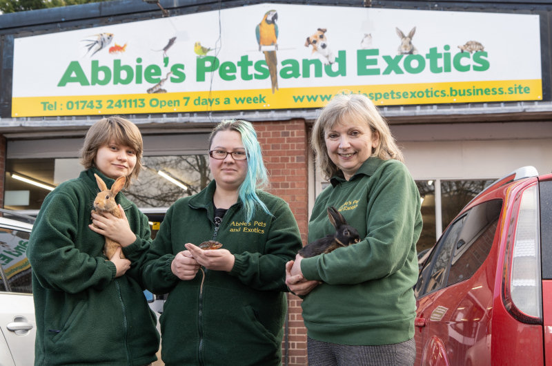 Shannon McManus, Sarah Smout and Karen Smout outside the new, larger Abbie's Pets and Exotics