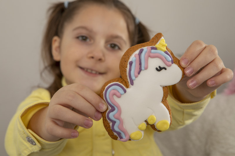 Millie Horbunowicz with Millie the Unicorn Gingerbread Biscuit