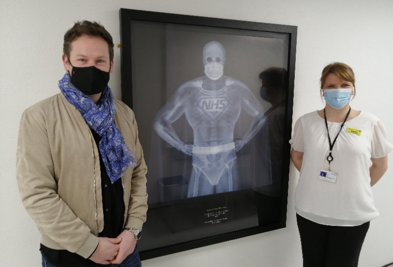 Jonathan Soden with Claire Baker and the donated artwork